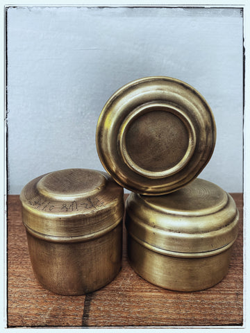 Little brass tins