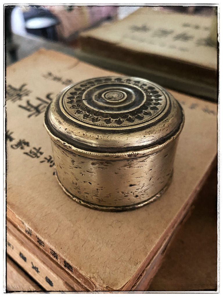 Vintage ornate brass tin