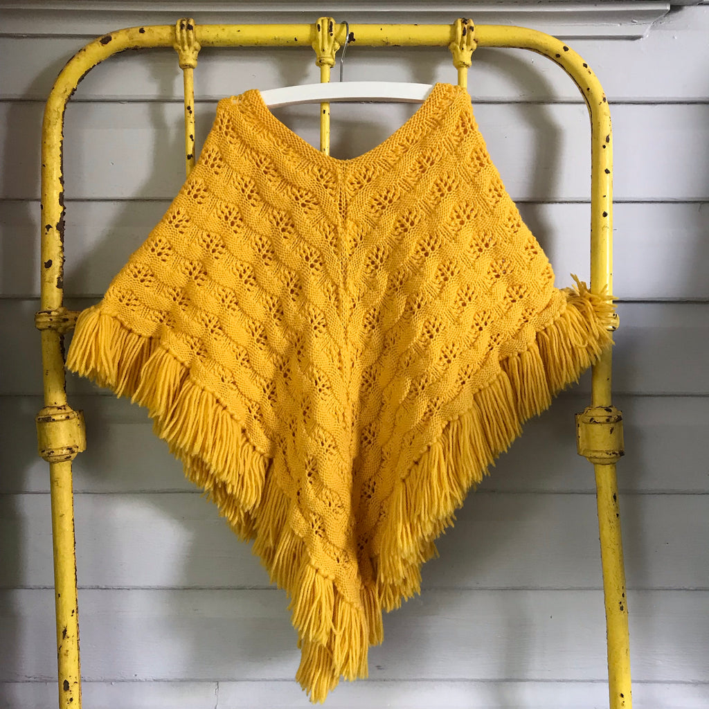 Handknitted poncho size 7-10yrs