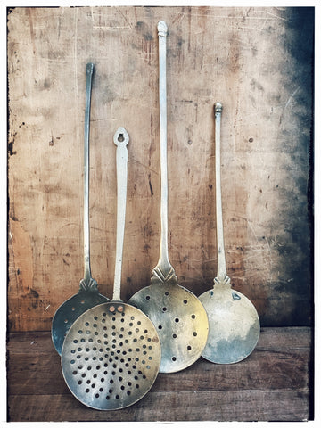 Vintage brass frying spoons