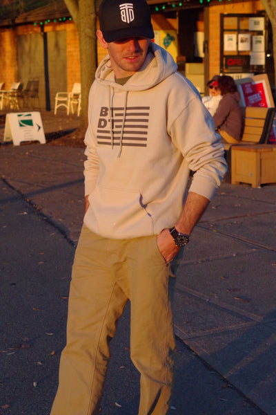 Tan hooded sweatshirt with our flag logo across the entire chest. Let others know you've been there, done that!