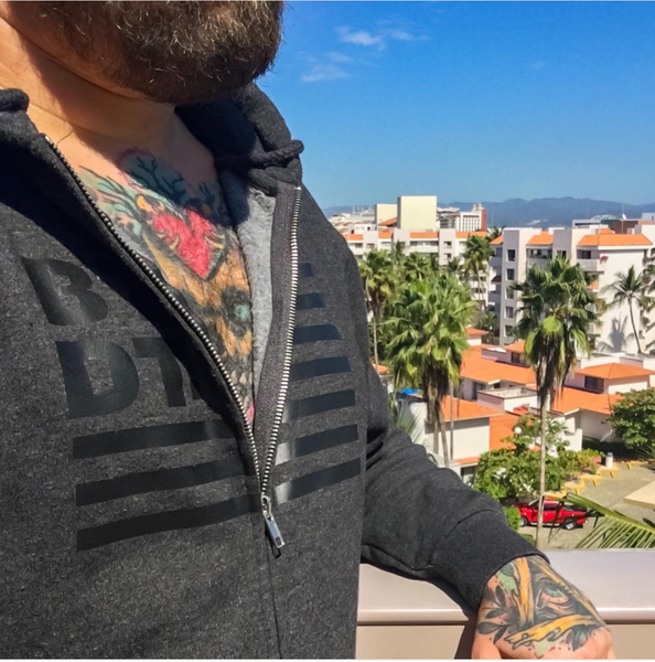 Black on Gray zippered hoodie with our subdued flag logo across the entire chest. Let others know you've been there, done that!