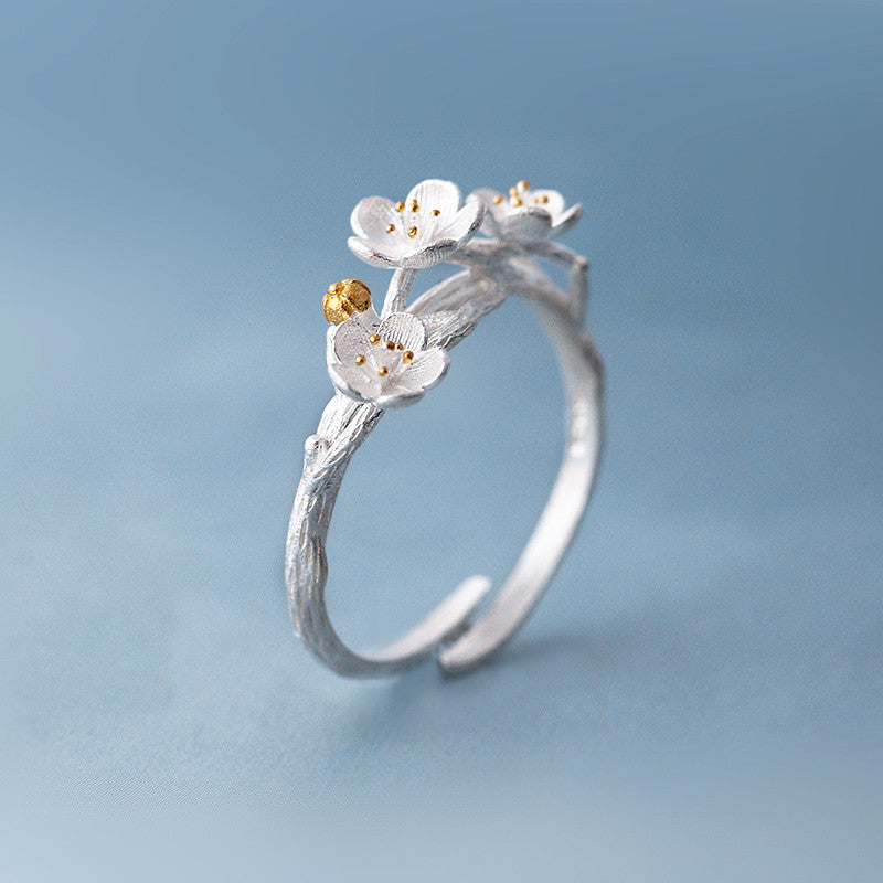 The cherry blossom branch resizable open ring in white copper silver plated