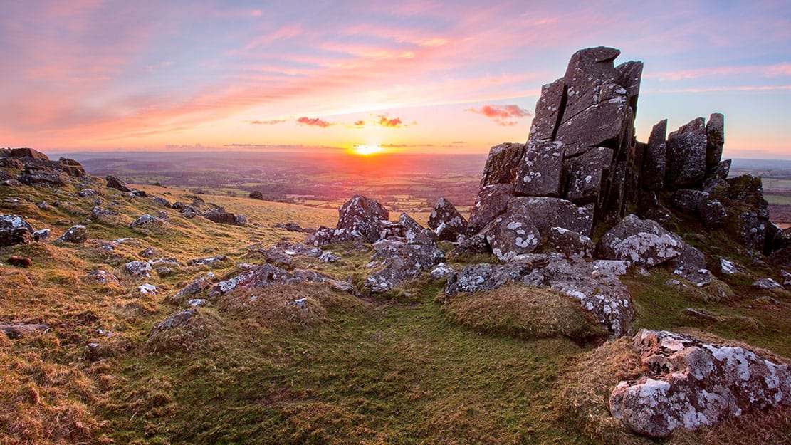 Sunset on Sourton Tor Dartmoor National Park Devon UK