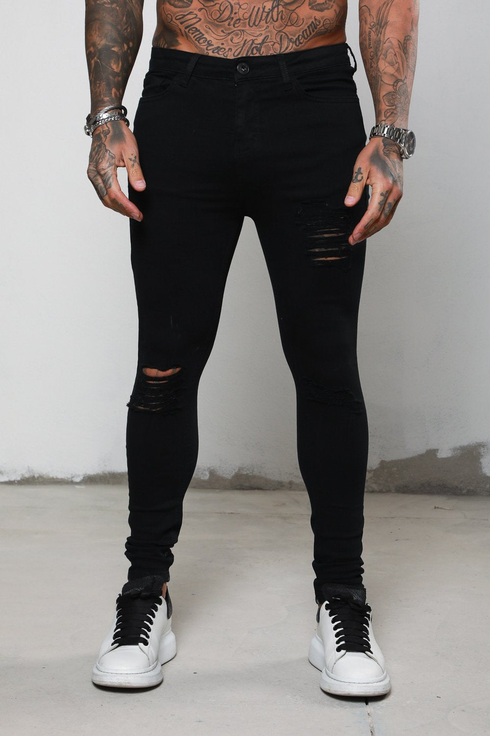 Surreal Ripped and Repaired Black Jeans