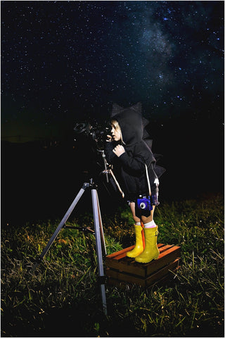 kid in dino hoodie looking at stars