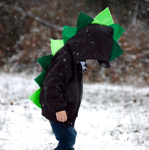 boy-playing-in-the-snow-ombre-green-black-hoodie