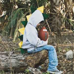 little-boy-playing-football-in-jeans-and-handmade-fashion-hoodie