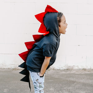 red spike fire dragon with black jacket on preschooler