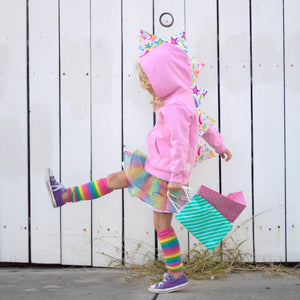 toddler-girl-playing-pink-hoodie-rainbow-skirt