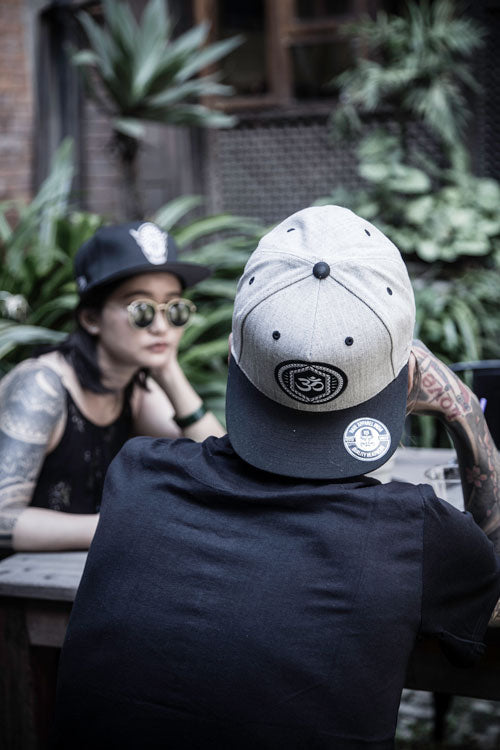 Mid Week Mood With The Left Fist & Om Snapback
