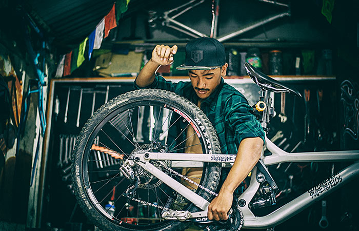 Suman Tamang MTB Rider Green Flannel Shirt & Haul Leather Camo Snapback Hat