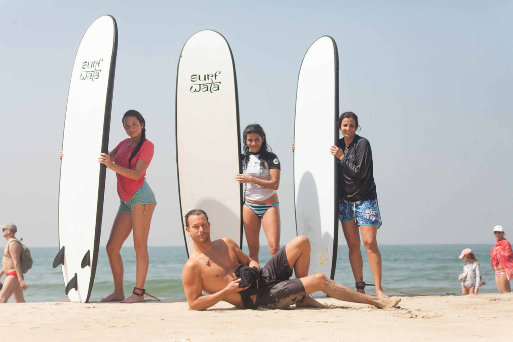 Chris giving begineer surfing lesson at surf wala goa