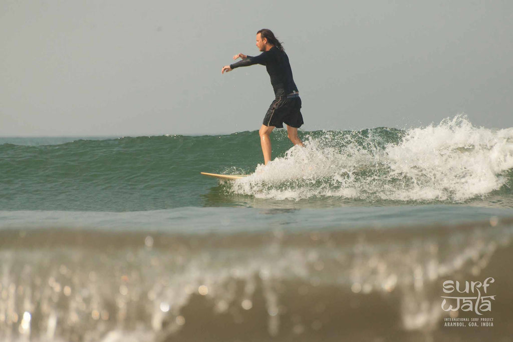Chris Catching some waves in india