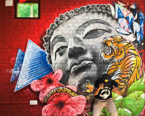 zake and his new graffiti in india. zake also rocks the aamchi mumbai hat