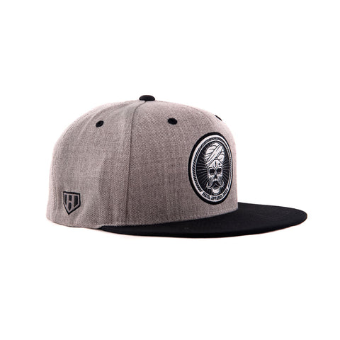 Skull Stache Woven Embroidery Label Heather Grey Colour Snapback Hat Side View With Adjustable Plastic Clasp by Haul Apparel