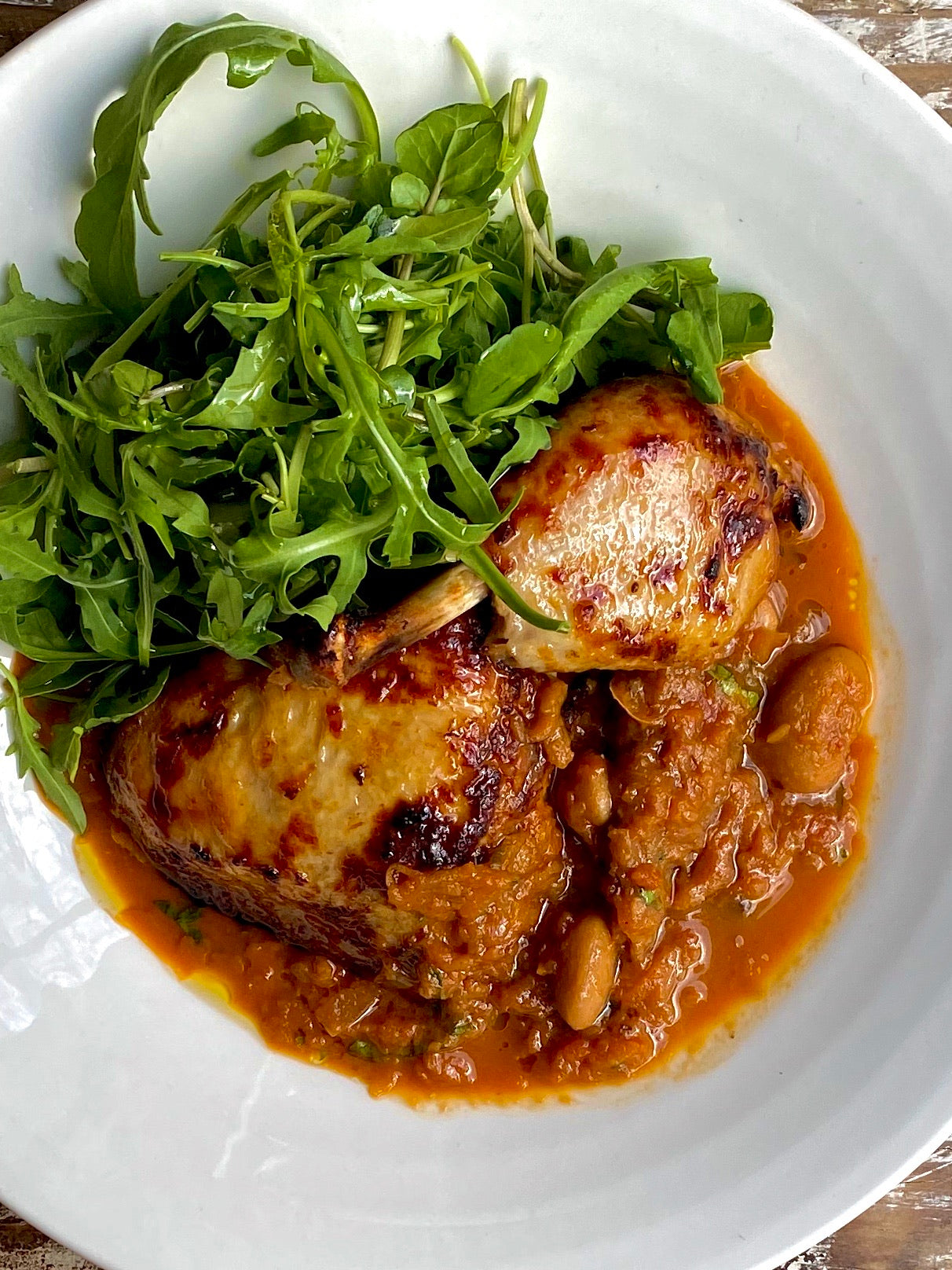 Norfolk white free range chicken leg with Toulouse sausage, tomato & butterbean sauce