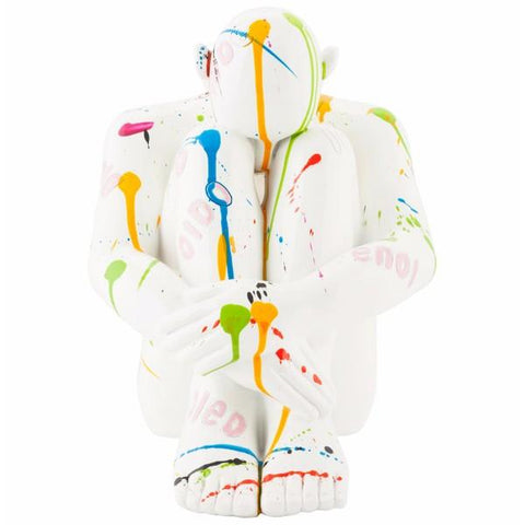 Paint Splattered Hunched Female Statue