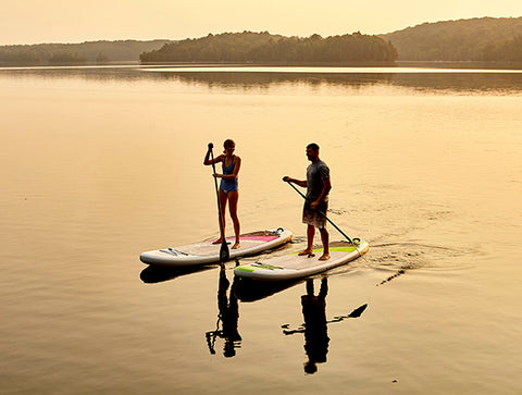 Stand up paddler boarders on a calm lake