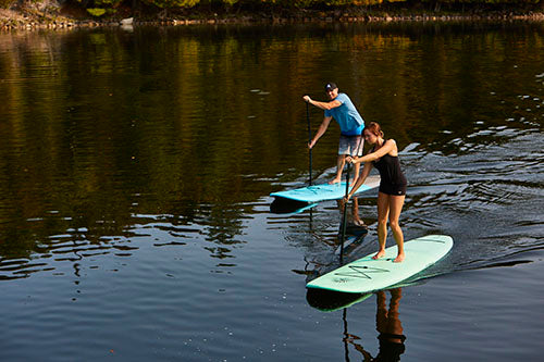 couple on performer paddleboard