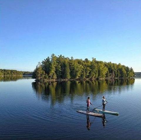 Stand up paddle boarding on a calm lake