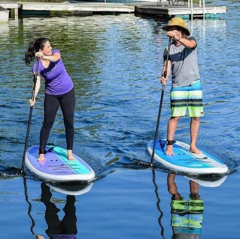 A couple paddle boarding on the Cruiser SUP Dura-Maxx boards