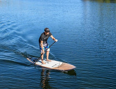 Glenn Morton, Customer Experience Manager for Paddleboard Direct, stand up paddle boarding on a lake