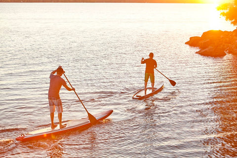 Stand Up Paddle Boarders of Different Weights