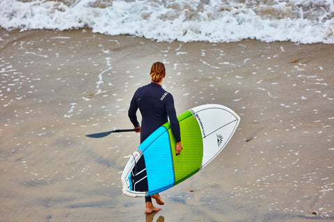 A Male  Stand UP Paddle Boarder
