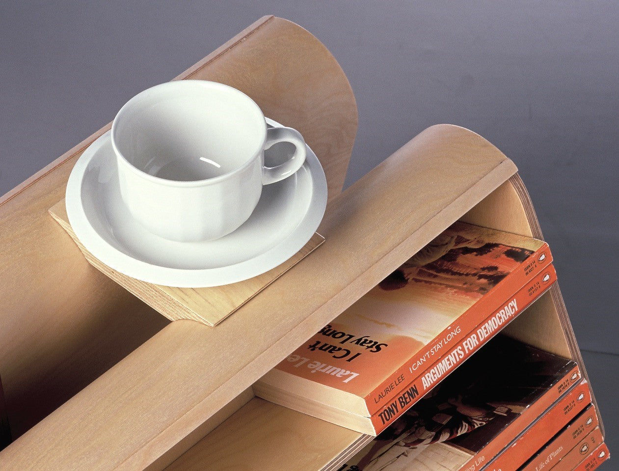 Coffee cup tray sitting atop curved bookcase