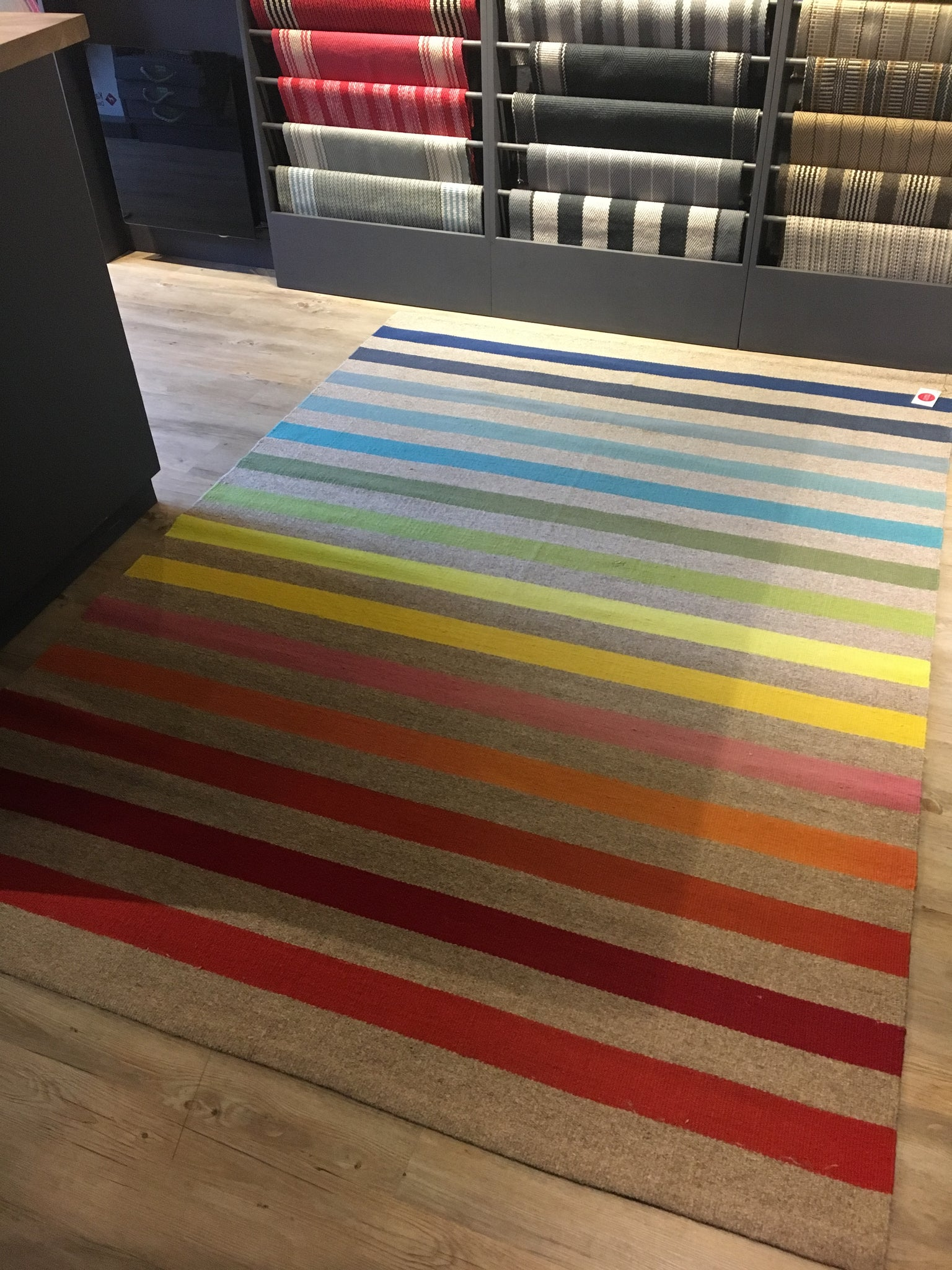 Rainbow striped flatweave rug