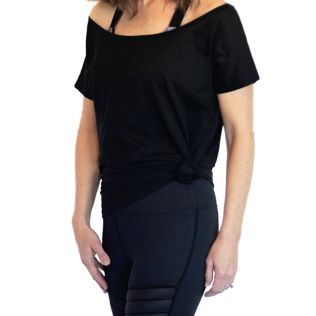 Fit For Barre Off The Shoulder Tunic designed in a cotton black fabric that can be worn long or tied up for a more fitted look.