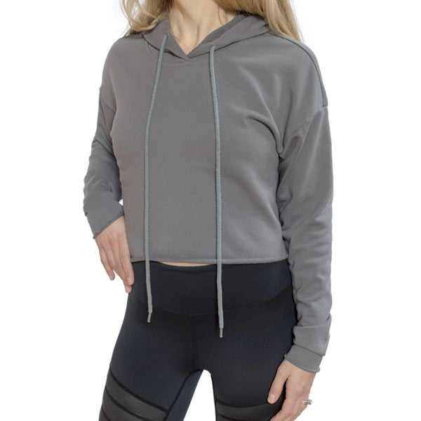 Fit For Barre Cropped Sweatshirt in grey with unfinished edges and includes a hood and a drawstring hoodie.
