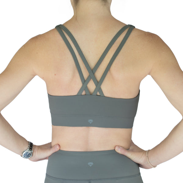Fit For Barre Rainbow Sports Bra in grey, accented with double straps in the back and rainbow design in the front.