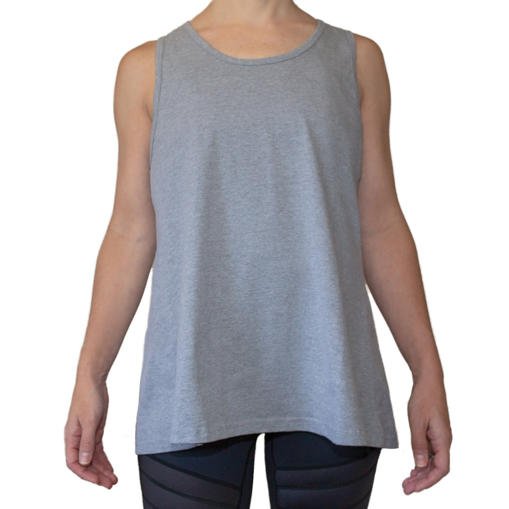 Fit For Barre Flowy Open Back Tank in black or heather grey, designed for a relaxed fit or tied in the back for a fitted style.