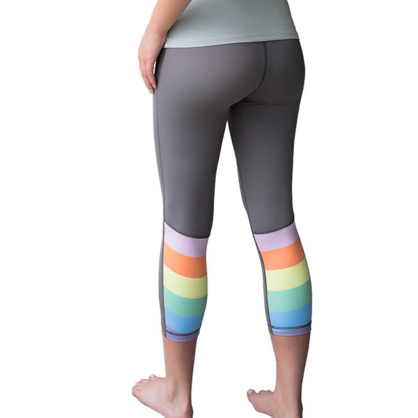 Fit For Barre Rainbow Block Legging in grey and accented with a rainbow pattern on the back, bottom portion of each leg.