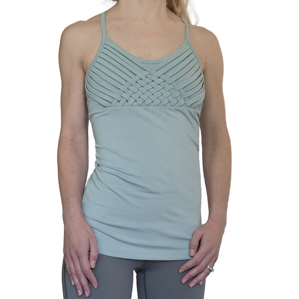 Fit For Barre Intricate Weave Tank with criss cross back and weaving around bust area. Designed in a grey (with green undertones) polyester blend fabric.