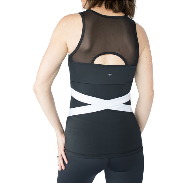 Fit For Barre White Banded Tank in a black nylon blend fabric and accented with a white band pattern around the waist and a mesh back.