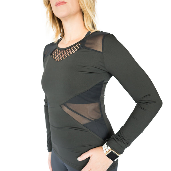 Fit For Barre Mesh Cut Out Top in a fitted black long sleeve style, accented with mesh and thumbholes.