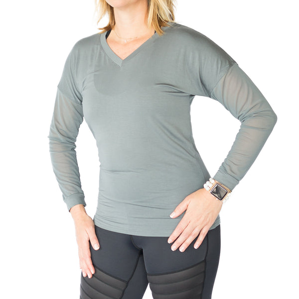 Fit For Barre V Neck fitted top in a grey bamboo blend fabric, accented with mesh sleeves.