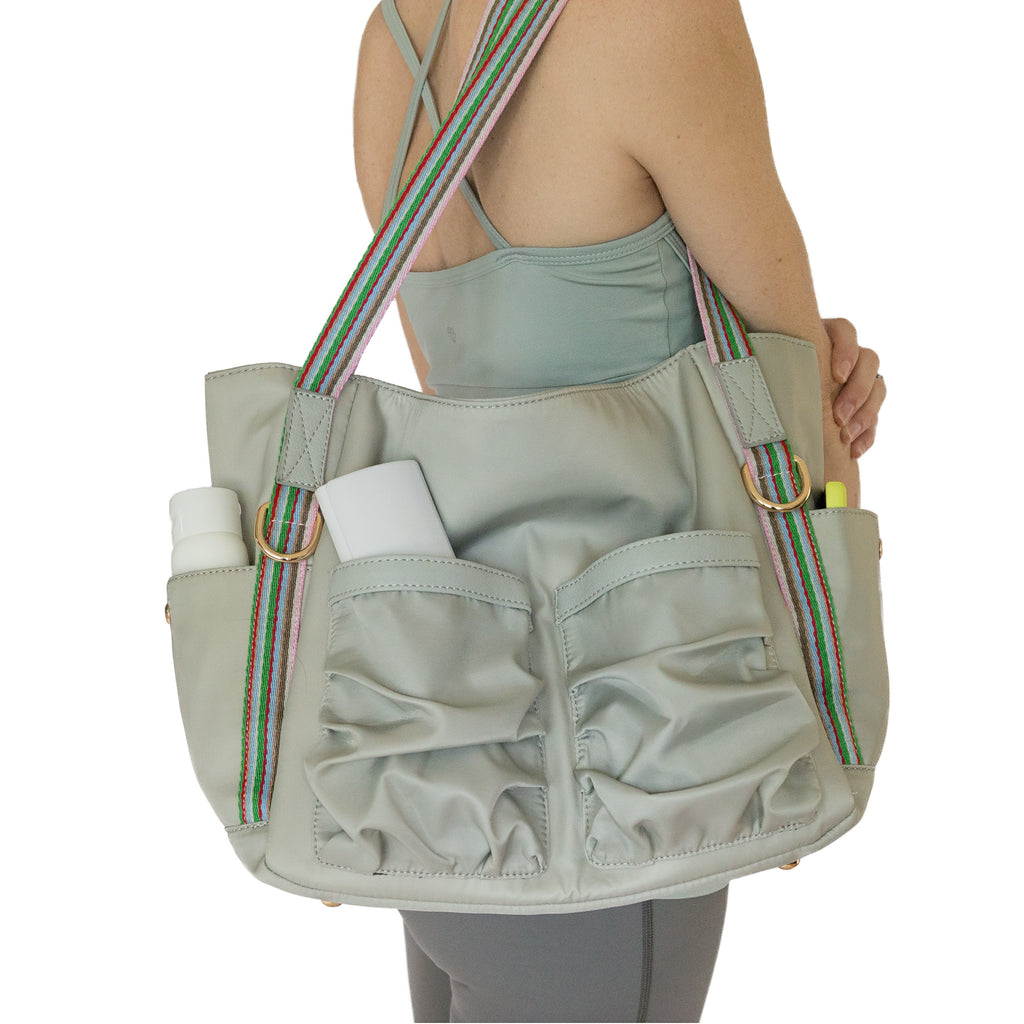 Fit For Barre Studio Tote in grey nylon fabric with colorful canvas straps and lots of pockets.