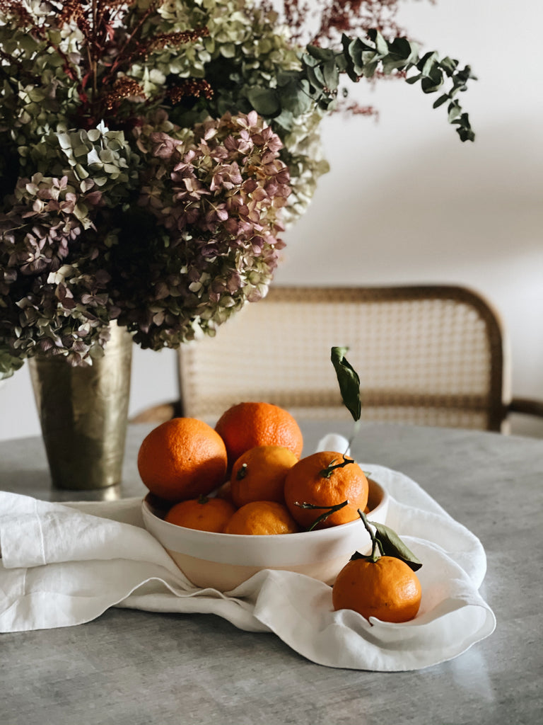 festive bowl of clementines with Piglet linen napkin