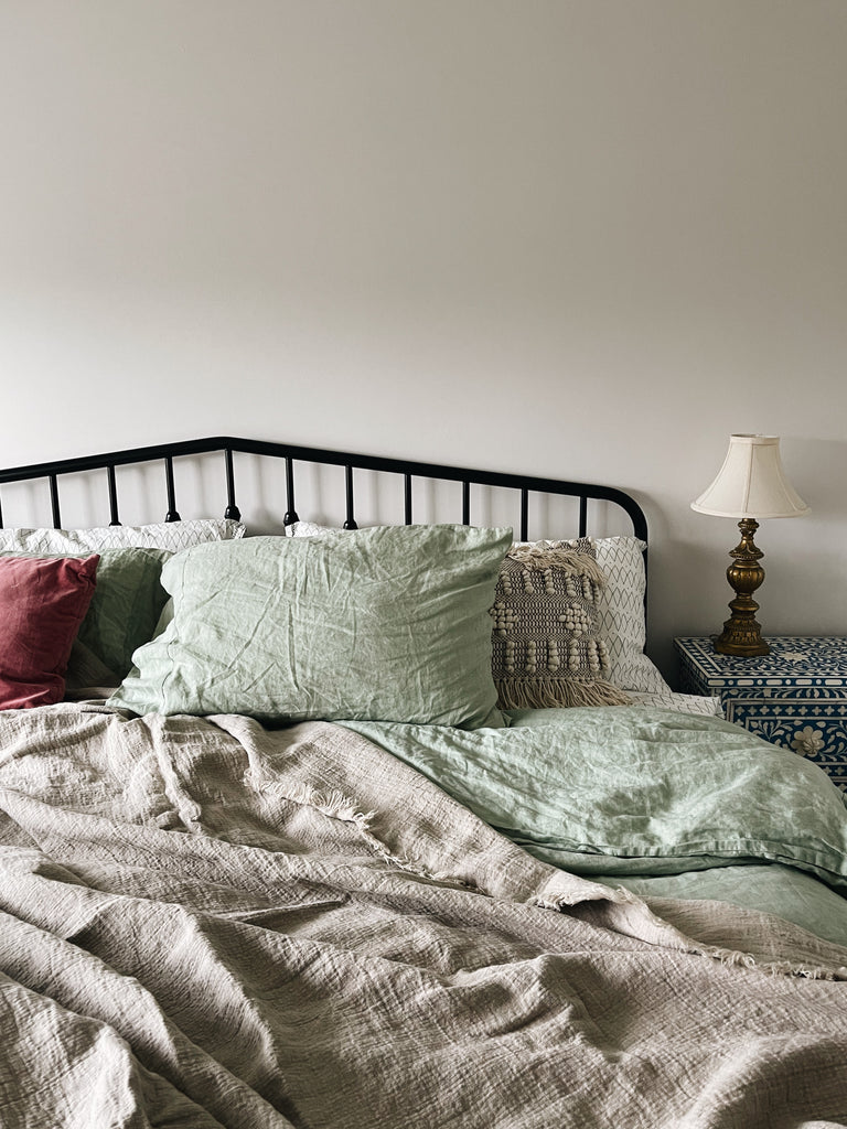 cosy bed covered with Piglet linen throws