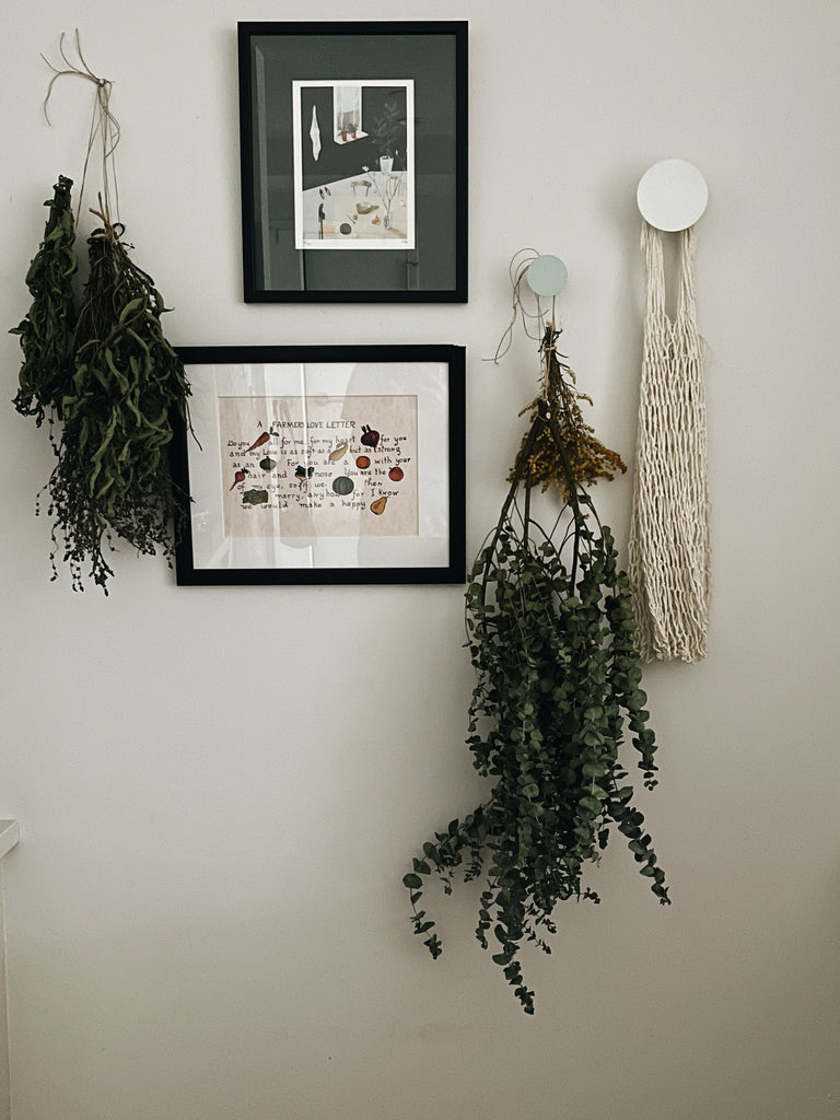 festive bunches of dried greenery hanging from wall