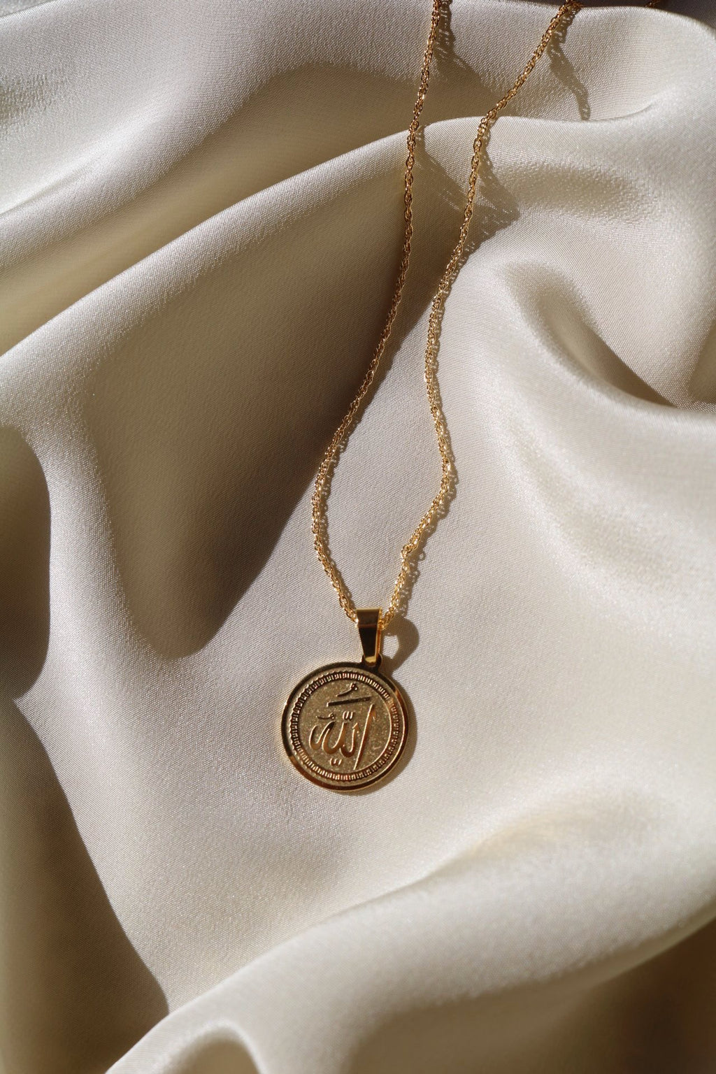 medallion pendant with gold chain