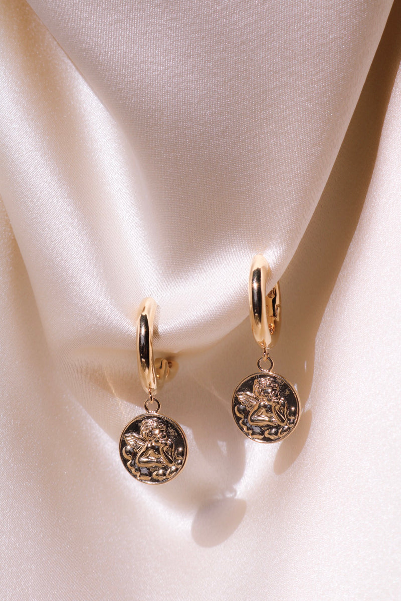 Earrings with drops and angel engraving