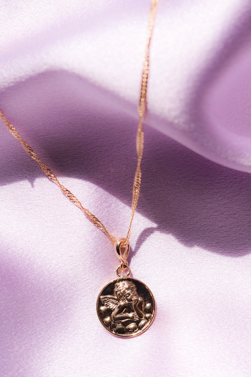 Pendant with angel engraving
