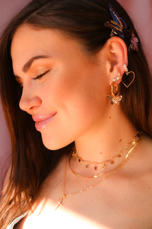 Woman Wearing Gold Plated Butterfly Studs