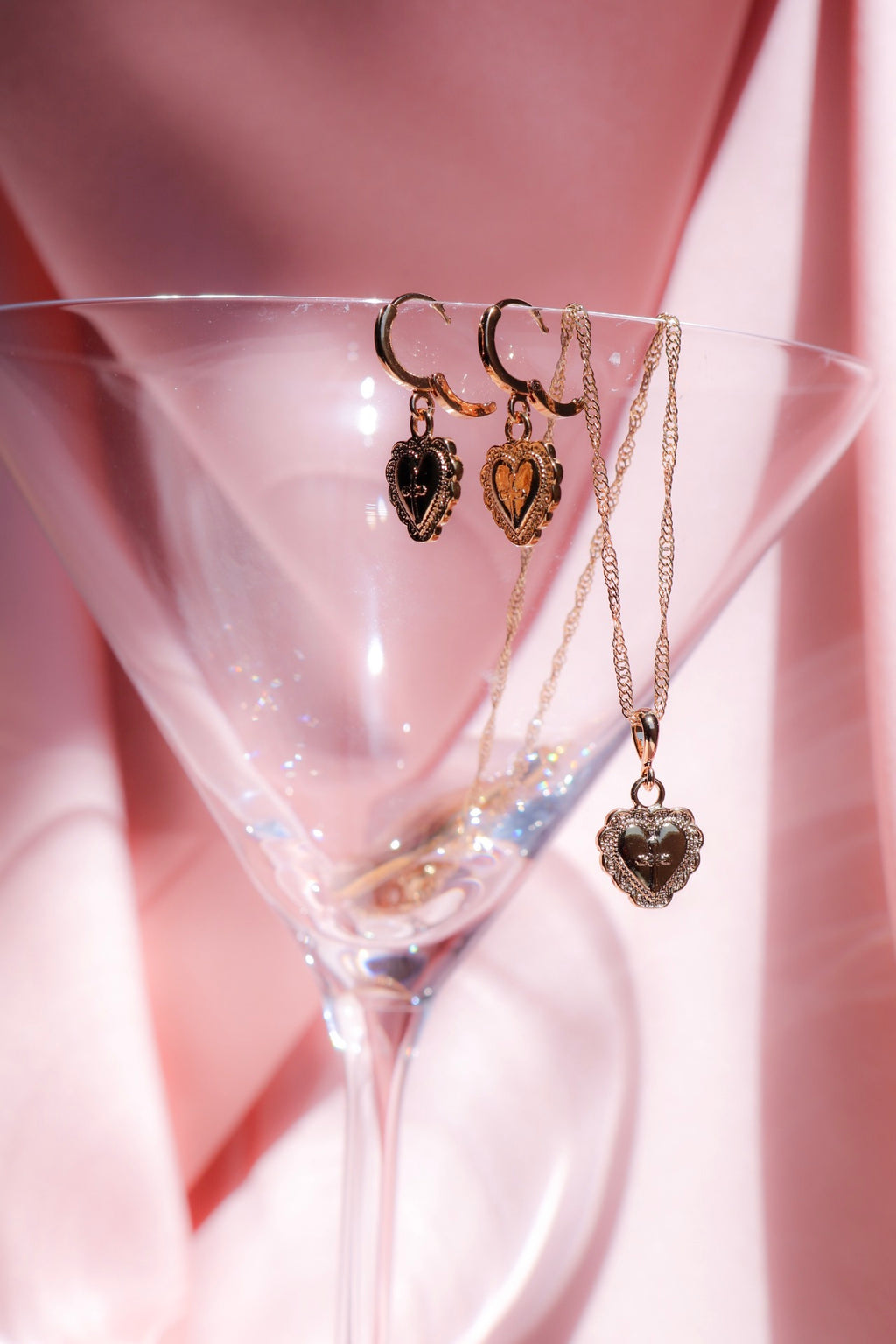 heart earrings with cross engraving