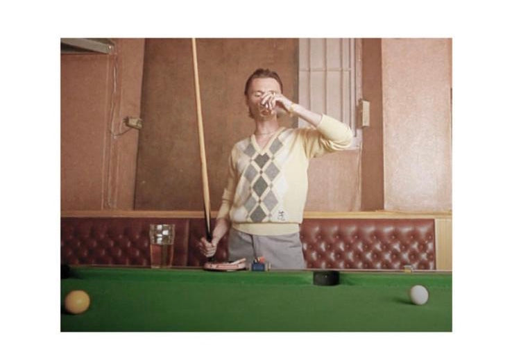 Francis Begbie wearing classic argyle sweater while drinking and playing pool